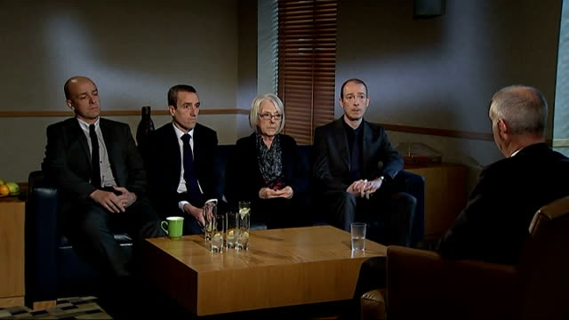family still hopeful of finding his murderer ENGLAND INT Various shots of reporter sitting with Elizabeth Johnson and Mark Blakelock's sons Mark Lee...