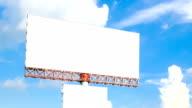 blank advertising billborad against blue sky