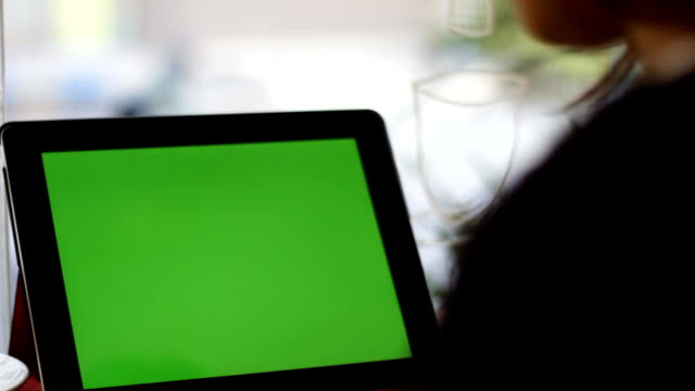 blank green screen tablet slide close up with hand