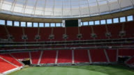 Blank scoreboard above empty stands at Estádio Nacional Mané Garrincha
