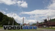 Blast Furnaces at the Voestalpine Stahl Donawitz GmbH plant stand in the valley as a mountain range stand beyond in Donawitz Austria on Tuesday May...