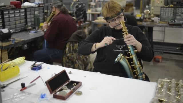 EK Blessing manufacturing brass instruments trumpets saxaphones trombones blow torch Indiana EK Blessing Co Brass Instrument Manufacturing on...