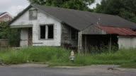 Blighted homes and abandoned and boarded up properties in New Orleans neighborhood of Hollygrove left over from Hurricane Katrina