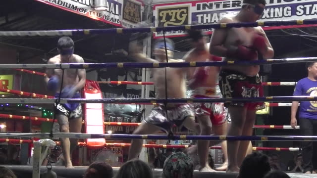 Blindfolded fighters compete in Muay Thai boxing at Thaphae Boxing Stadium in Chiang Mai