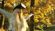 Blond beauty having fun with VR in nature