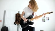 Blond girl playing guitar
