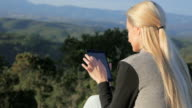 Blond girl with tablet in nature