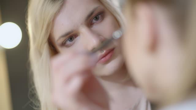Blond transgender make-up artist working