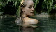 Blond woman in a natural pool