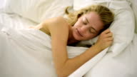Blond woman in bed