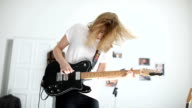 Blond woman playing guitar