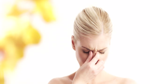 Blond woman with sinus pain