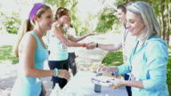Blonde athletic woman registering for 5k or charity marathon race