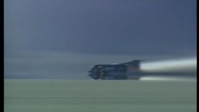 Bloodhound supersonic car attempts to break land speed record BSP151097017 / Nevada Black Rock Desert Thrust SSC along thru desert trailing dust...