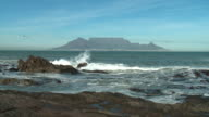 MS Bloubergstrand rocky shore with Table mountain in background, Cape Town, Western Cape, South Africa