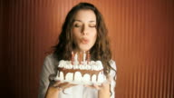HD: Blowing birthday cake candles