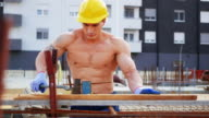 Blue collar worker on construction site, banding armature