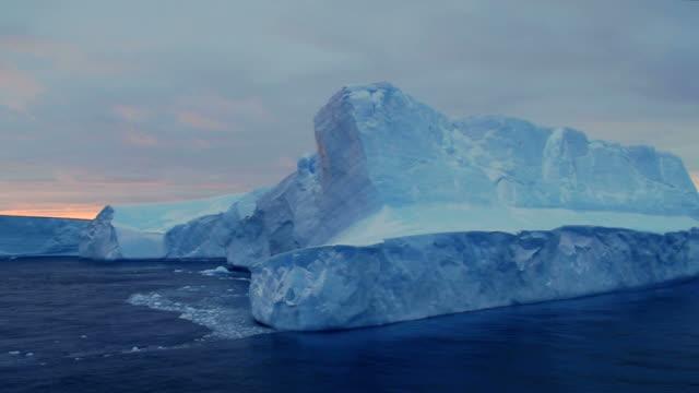 Blue Iceberg under brooding skies