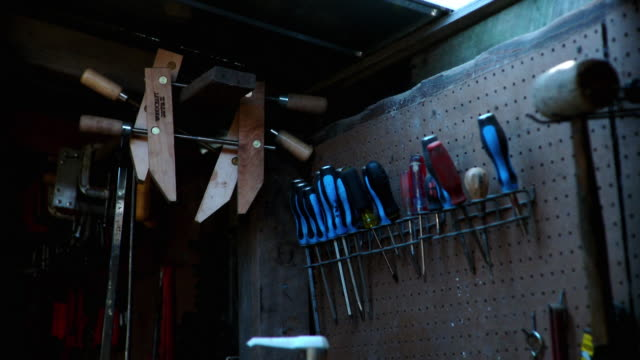 CU Blue screwdrivers hanging from rack on wall in workshop, Live Oak, Florida, USA