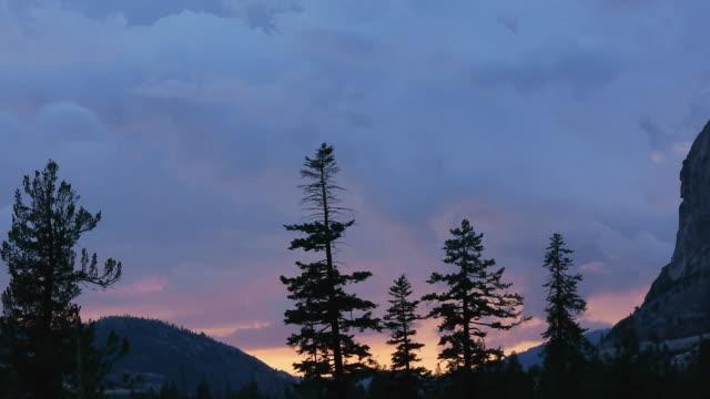 TL MS Blue storm clouds, orange sunlight over wilderness valley, sunset, wild & scenic Tuolumne River, Yosemite National Park, California