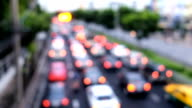 Blur traffic road with bokeh light abstract background, Bangkok Thailand, Transportation concept.