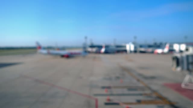 Blurred background airplane moving to broading bridge at the airport