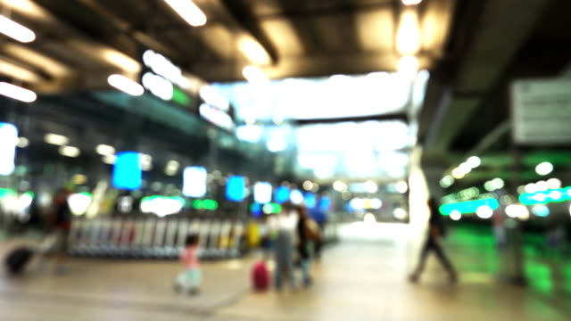 Blurred motion of Airport travelers.