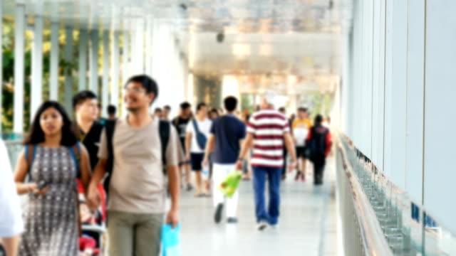 Blurred people walking in downtown