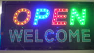 LED board with 'OPEN WELCOME' word.