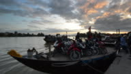 Boat being unloaded at sunset, Bach Dang Docks, Hoi An, Vietnam