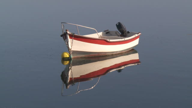 MS Boat bobbing on water and reflection seeing in water / Saint-Cado, Brittany, France