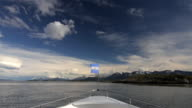 Boat bow with Argentina national flag while crossing Beagle Channel