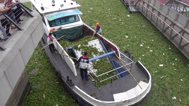A boat cleans the water on Huangpu River in Shanghai