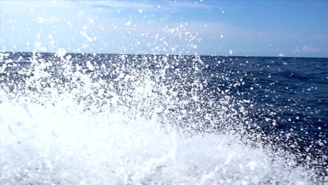 SLO MO Boat cruising in the sea