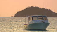 MS Boat floating on the sea at sunset / Brightown, Barbados