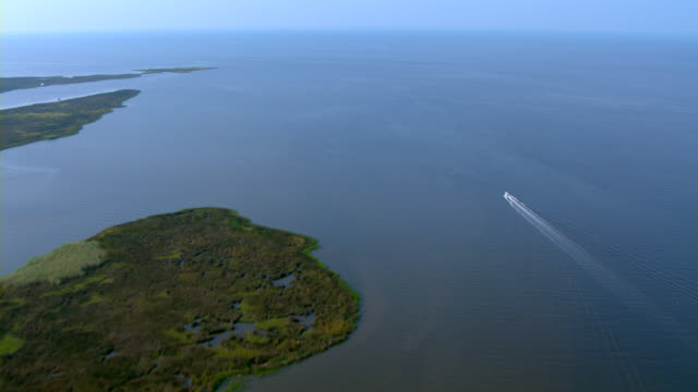 A boat heads past the Twin Islands in Pascagoula Bay.