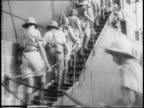 Boat in water / Charles de Gaulle shakes hands with men in uniform / panning shot of De Gaulle and General Archibald Wavell in Cairo Egypt / De...
