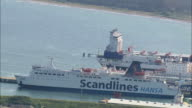 WS AERIAL Boat is moving in sea from dock / RuegenSassnitz, Mecklenburg-Vorpommern, Germany
