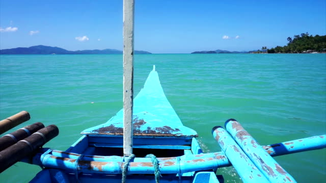 POV boat journey through clear tropical water