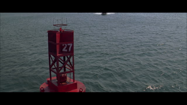 WS Boat making high speed turn past floating buoy