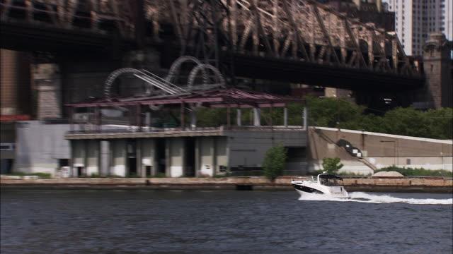 Boat passes under Ed Koch Queens Boro Bridge