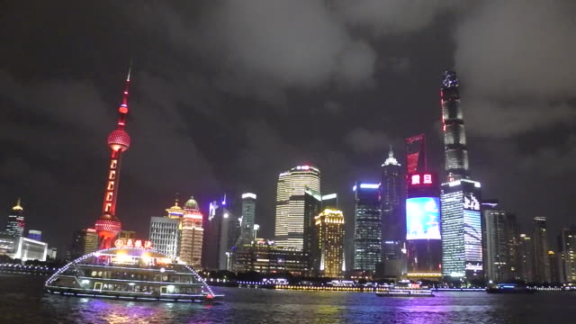 Boat ride on Huangpu River at night in Shanghai