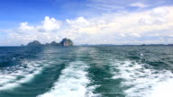 Boat riding at Andaman sea with island background