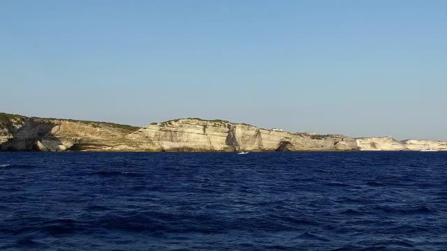 Boat sailing along the cliff in Bonifacio in Corsica, France