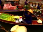 Boat traffic along canal at Floating Market, Bangkok, Thailand