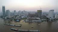 Boat Traffic on The Busy Chao Phraya River in Bangkok, Thailand,