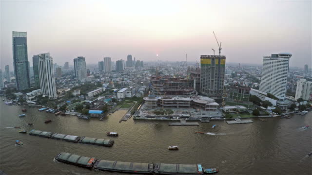 Boat Traffic on The Busy Chao Phraya River in Bangkok, Thailand,