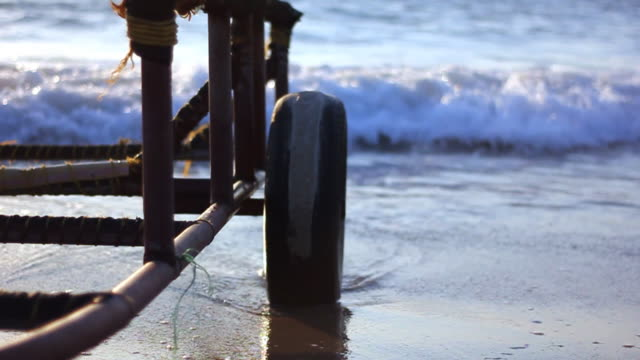 Boat trailer close-up, hit by wave slow motion