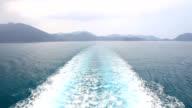Boat wake in the blue sea