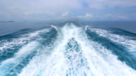 Boat wake on the blue ocean sea